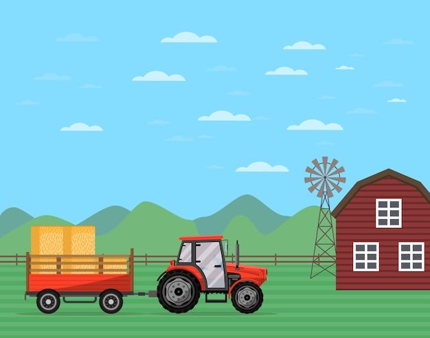 干し草バナーとトレーラーを引っ張るトラクター