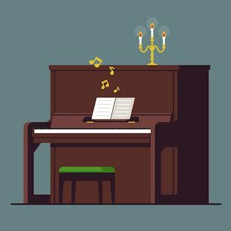 ノートとローソク足で茶色のアップライトピアノ。クラシック音楽のロマンチックな夜。