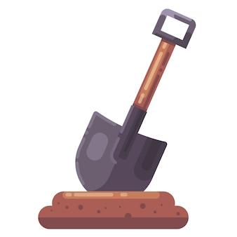 シャベルが地面に引っかかった。穴を掘る