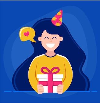 Девушка держит в руках подарок и поздравляет с днем рождения.