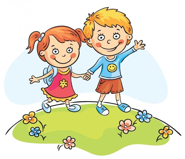 屋外を歩く幸せな子供たち