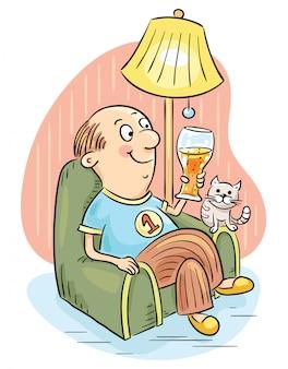 アームチェアでビールを飲む男性