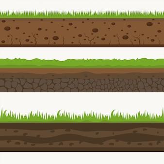 土壌シームレス層グランド層。土の上の石と草。