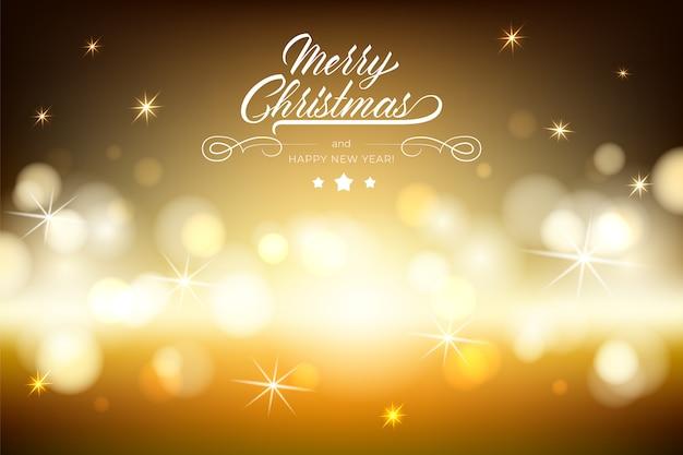 Веселого рождества надписи на коричневый фон с размытия золотой боке светового эффекта.
