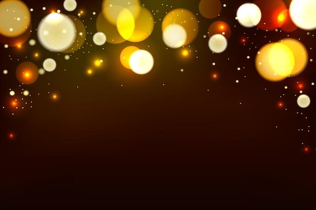 Абстрактный коричневый фон с золотым боке светового эффекта.
