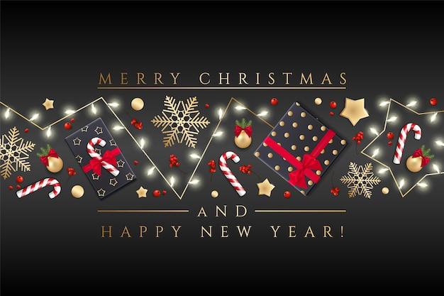 メリークリスマスと幸せな新年のグリーティングカードクリスマスライト、金の星、雪、ギフトボックスの休日の背景