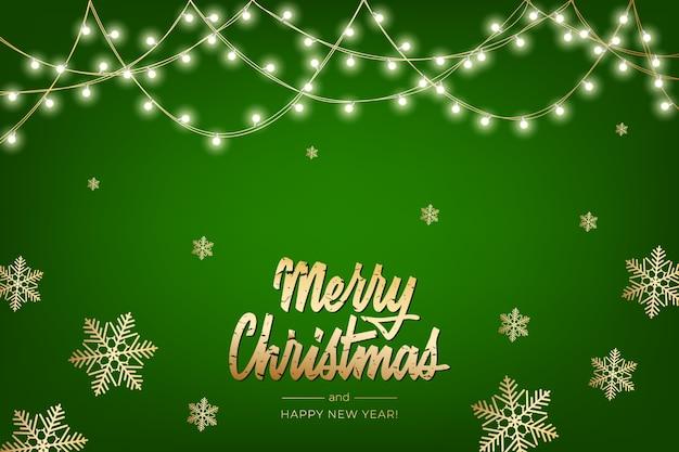 光の花輪とメリークリスマスと幸せな新年をレタリングメリークリスマスグリーティングカードの休日の背景。