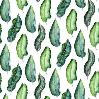 熱帯の葉の密なジャングルのシームレスな水彩パターン。手描きのヤシの葉。