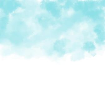 手は水彩の空と雲、抽象的な水彩の背景を描いた