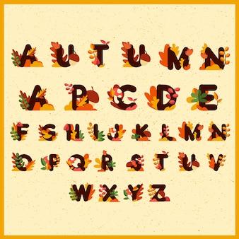 秋の季節のかわいいアルファベットパターンまたは背景の葉、花、キノコ、クルミの装飾