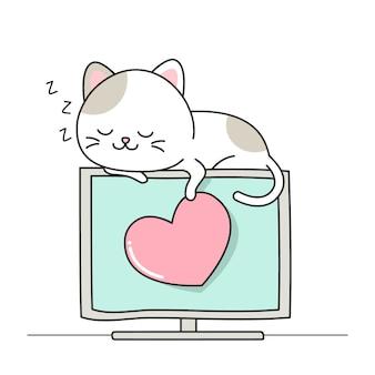 幸せなかわいい猫がモニターで寝る