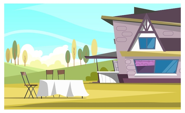屋外での美しい家と丸いテーブル