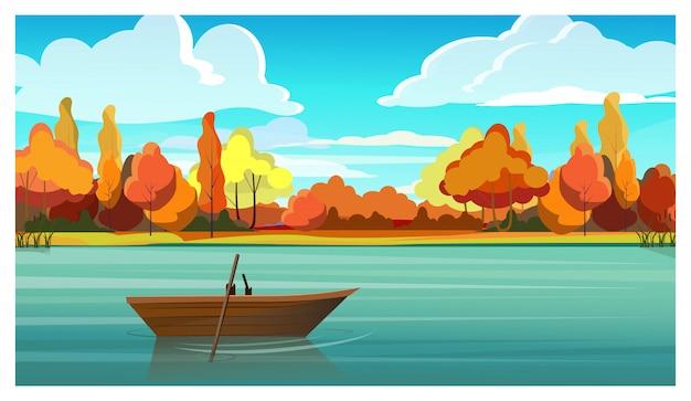 背景に空のボートと秋の木がある湖