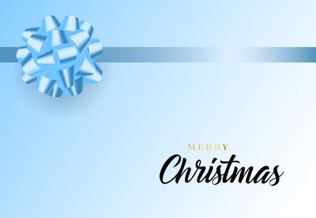 メリークリスマスの文字と青いリボンの弓