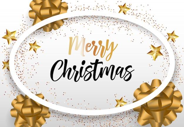 金の弓と楕円形のフレームでメリークリスマスレタリング