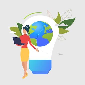 Женщина, используя ноутбук, лампочку, земной шар и зеленые листья