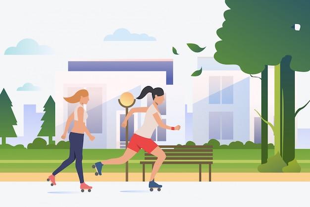 バックグラウンドで遠くの建物と公園でスケートをする女性