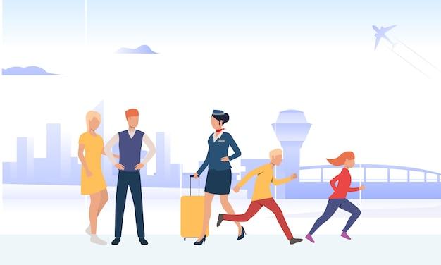 空港従業員が荷物を運ぶ