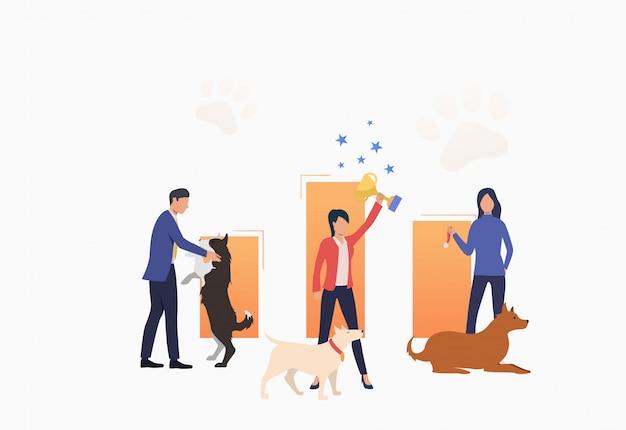 犬の所有者が勝利を祝って、トロフィーを保持