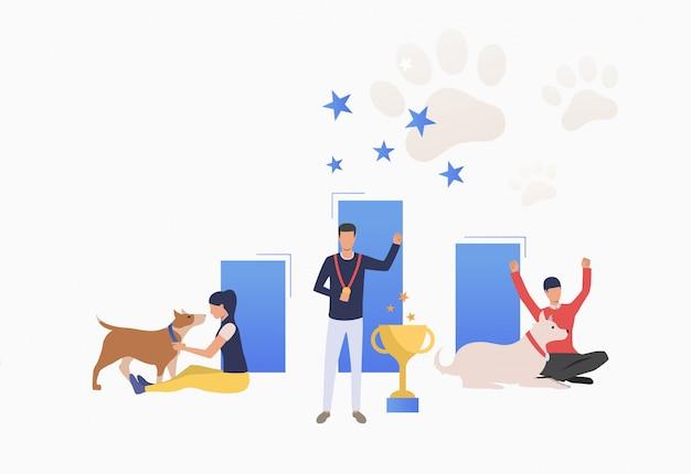 犬のショーで勝利を祝っている犬の所有者