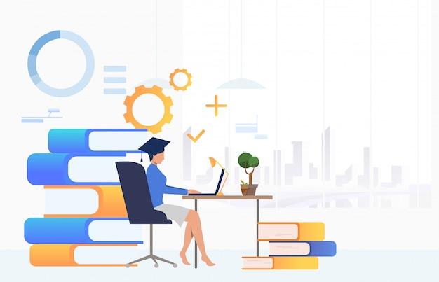 Студент учится на столе