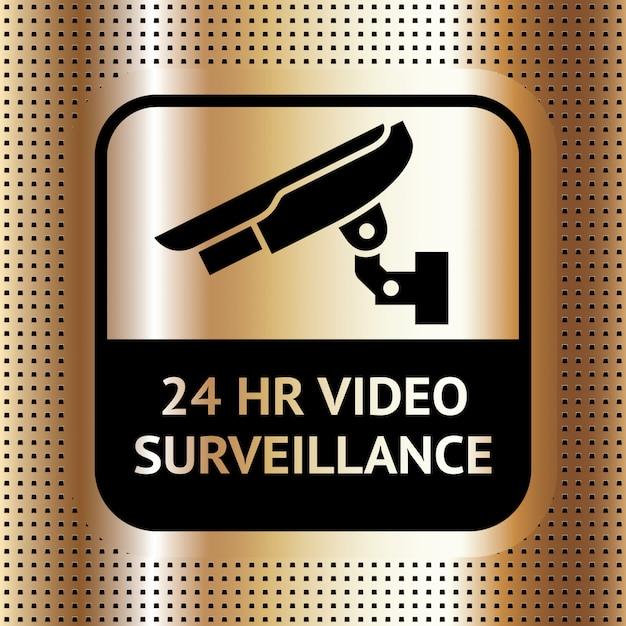 金色の点線の背景にビデオ監視記号
