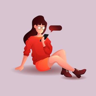 Девушка с мобильным телефоном сидит на полу