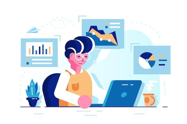 若い男が仕事机でオフィスに座って、ノートパソコンでの作業します。