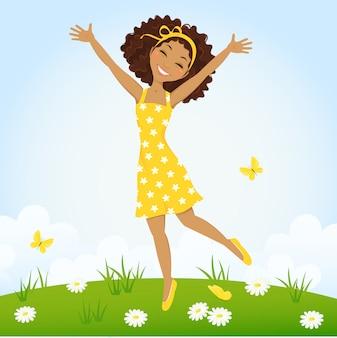 春の牧草地でジャンプかわいい女の子