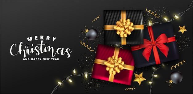 Праздничный фон с реалистичными подарочными коробками, сверкающими легкими гирляндами, рождественскими шарами и золотым конфетти.