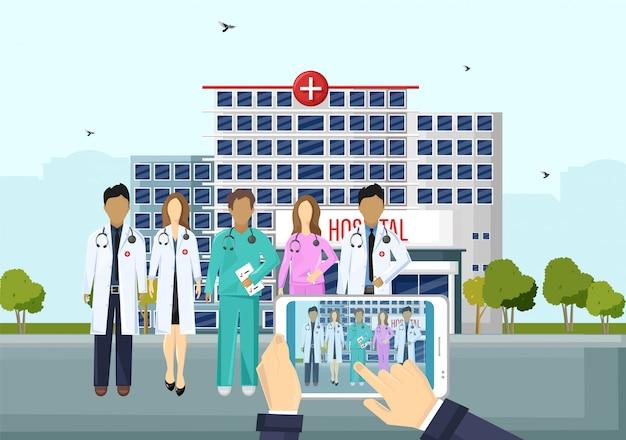 病院のイラストの前に医師チーム