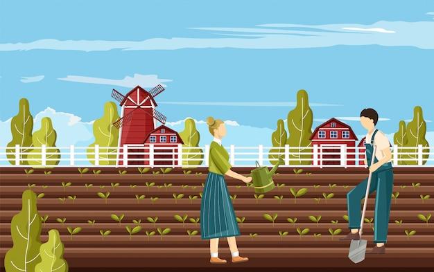 Пара фермеров, работающих в саду