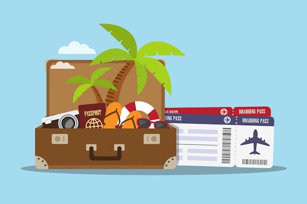 Композиция с чемоданом и аксессуарами для путешествий