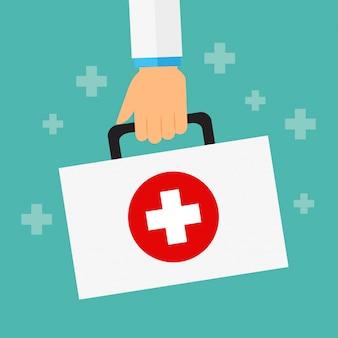 医者の手の救急箱または医療用ブリーフケースを保持