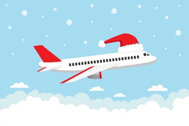 Самолет, летящий в небе с шляпой санты