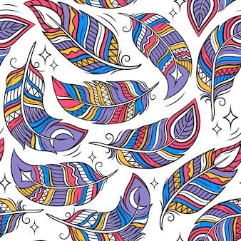 Бесшовный фон с цветными абстрактными перьями