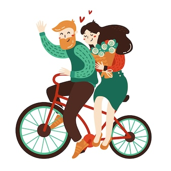 幸せなカップルは一緒に自転車に乗っています。