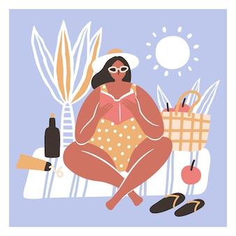 ビーチで本を読んでビキニの女性