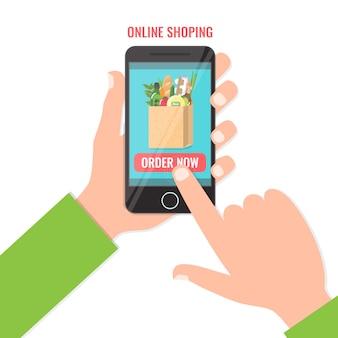 スマートフォンでオンラインで食べ物を購入します。オンラインビジネスをショッピング、今コンセプトを注文します。 。