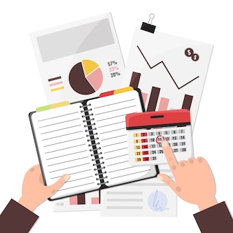Бизнесмен планируя его работу в бумажных тетради и календаре.
