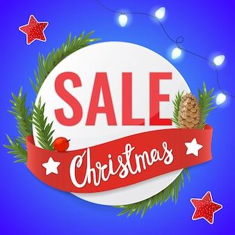 Рождественская распродажа света гирлянды, ленты, еловые ветки и рождественские надписи. рекламный баннер.