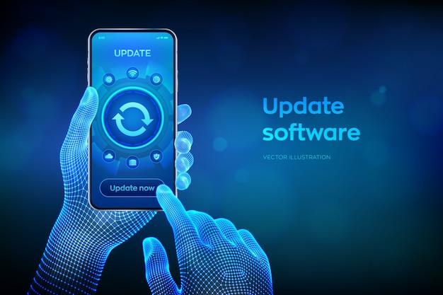 ソフトウェアを更新します。スマートフォンの画面でソフトウェアバージョンをアップグレードします。コンピュータープログラムアップグレードビジネステクノロジーインターネット。ワイヤーフレームの手でスマートフォンをクローズアップ。図。