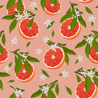 オレンジ色の果物は、花と葉とのシームレスなパターンをスライスします。