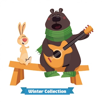Счастливый милый бурый медведь играет на гитаре с кроликом