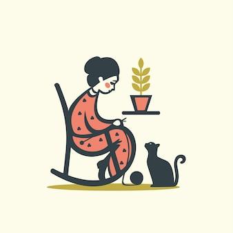 猫と編み物女性