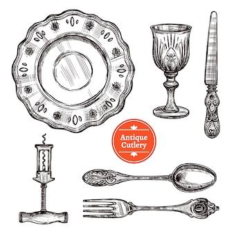 Набор антикварных столовых приборов