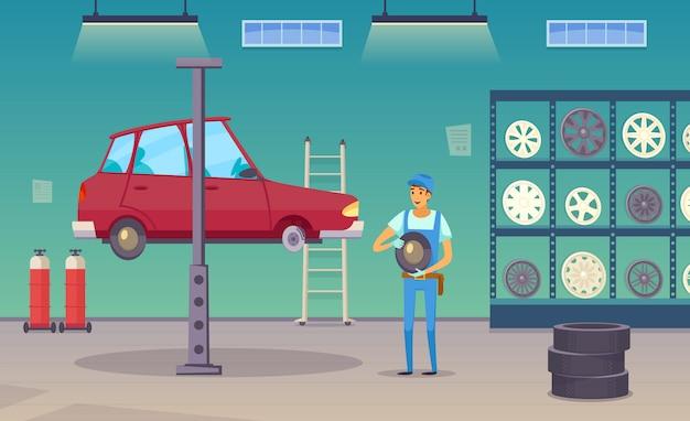 自動車修理店のサービス担当者が損傷したタイヤと交換用ホイールを交換