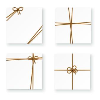 ロープコードの結び目を結ぶ白い小包パッケージボックス