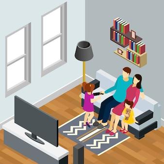 Молодая семья с двумя маленькими дочерьми смотрит телевизор