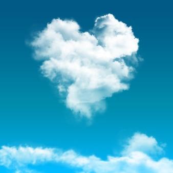 雲のある雲の合成で現実的な青い空が中心のハートのように見える